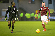 Northampton Town Midfielder Nicky Adams and York City Defender Femi Llesanmi chase the ball during the Sky Bet League 2 match between Northampton Town and York City at Sixfields Stadium, Northampton, England on 6 February 2016. Photo by Dennis Goodwin.