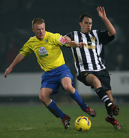 Photo: Paul Thomas.<br /> Notts County v Hereford United. Coca Cola League 2. 22/12/2006.<br /> <br /> Ian Ross (R) of Notts tries to tackle Andy Ferrell.