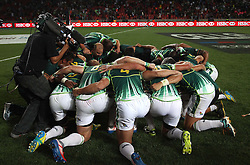 South Africa pray after beating New Zealand to win the Cup Final during the Cup Final match between South Africa and New Zealand on Day 2 of the HSBC Sevens World Series Port Elizabeth Leg held at the Nelson Mandela Bay Stadium on 8th December 2013 in Port Elizabeth, South Africa. Photo by Shaun Roy/Sportzpics