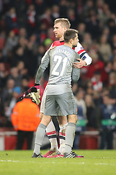 19.02.2014, Emirates Stadion, London, ENG, UEFA CL, FC Arsenal vs FC Bayern Muenchen, Achtelfinale, im Bild Per Mertesacker (Arsenal FC #4) mit Torwart Lukasz Fabianski (Arsenal FC #21) // during the UEFA Champions League Round of 16 match between FC Arsenal and FC Bayern Munich at the Emirates Stadion in London, Great Britain on 2014/02/19. EXPA Pictures © 2014, PhotoCredit: EXPA/ Eibner-Pressefoto/ Schueler<br /> <br /> *****ATTENTION - OUT of GER*****