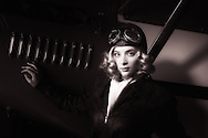 A young model posing as a late twenties aviatrix with a Command-Aire 3C3-T at WAAAM.