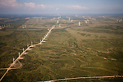 Lines of windmills run perpendicular to the prevailing wind in Sweetwater Texas.
