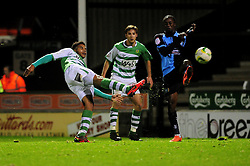 Yeovil Town's Reuben Reid volleys the ball from outside the box - Photo mandatory by-line: Dougie Allward/JMP  - Tel: Mobile:07966 386802 04/12/2012 - SPORT - FOOTBALL - Johnstone's Paint Trophy  -  Yeovil  -  Huish Park  -  Yeovil Town V Wycombe Wanderers
