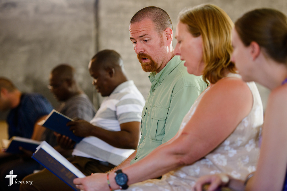 The Rev. Ryan McDermott, LCMS missionary to Togo, joins Stephanie Schulte and Molly Christensen, fellow LCMS missionaries, as they sing together during Vespers at the Lutheran Center for Theological Studies (CLET) on Tuesday, Feb. 14, 2017, in Dapaong, Togo. LCMS Communications/Erik M. Lunsford