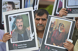 June 10, 2017 - Ankara, Turkey - A man holds portraits of the martyrs during a commemoration of Turkey's deadliest terror attack in Ankara. Two bombs were detonated outside the central railway station during a 'Labour, Peace and Democracy' rally with a death toll of 101 civilians and more than 500 injured in October 2015. (Credit Image: © Altan Gocher/NurPhoto via ZUMA Press)