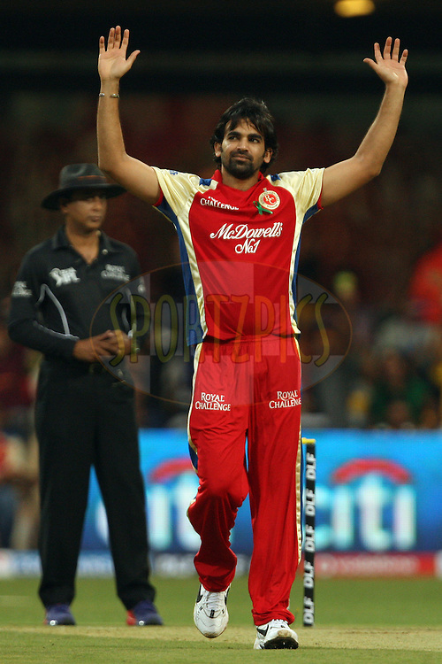 Zaheer Khan celebrates the wicket of Virender Sehwag during match 5 of the the Indian Premier League ( IPL) 2012  between The Royal Challengers Bangalore and the Delhi Daredevils  held at the M. Chinnaswamy Stadium, Bengaluru on the 7th April 2012..Photo by Jacques Rossouw/IPL/SPORTZPICS