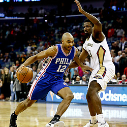 Dec 8, 2016; New Orleans, LA, USA;  Philadelphia 76ers guard Gerald Henderson (12) drives past New Orleans Pelicans forward Solomon Hill (44) the first quarter of a game at the Smoothie King Center. Mandatory Credit: Derick E. Hingle-USA TODAY Sports