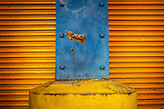 Vibrant colors of corrugated and rusty metal on a wall at Chelsea Piers, New York.