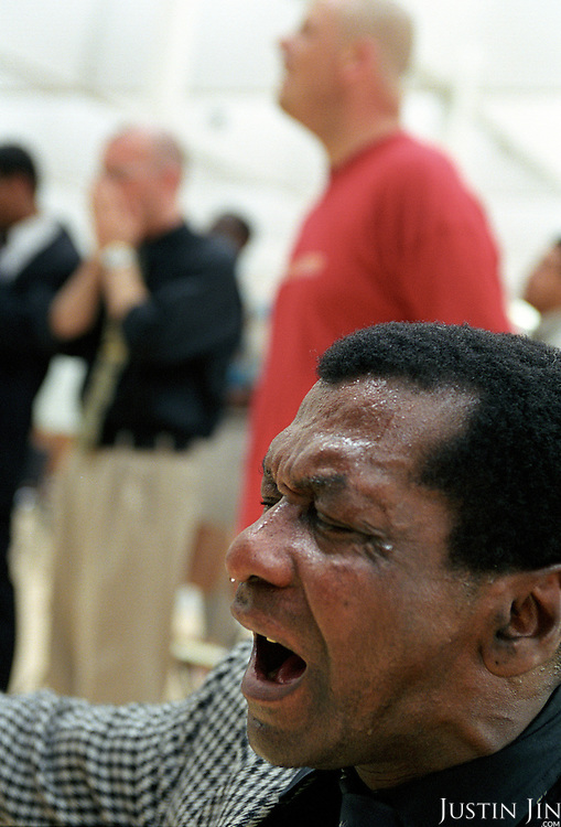 Ex-drug-addicts pray in Rotterdam..Victory Outreach, a controversial church started in Los Angeles in 1967, is spreading to Europe via the Netherlands. It builds its membership among junkies, prostitutes and criminals. ..Photo taken in the Netherlands in 2002. The picture is part of a photo and text documentary by Justin Jin. For more information, email justin@justinjin.com
