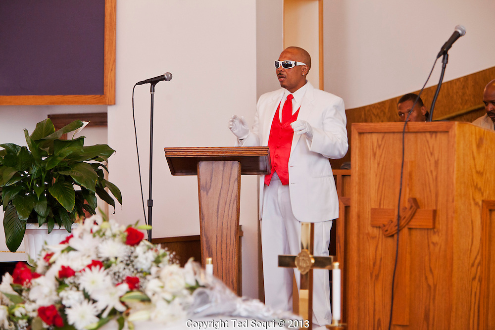 &quot;Lowdown,&quot; Kevin's best friend.<br /> Funeral services for Kevin &quot;Flipside&quot; White at Macedonia Church in Watts.<br /> White was shot dead in what is believed to be an unprovoked attack during a gang conflict at Watts' Nickerson Gardens and Jordan Downs housing projects.<br /> Flipside, 44, was a founding member of Watts' first major label hip hop act, O.F.T.B. (Operation From The Bottom).