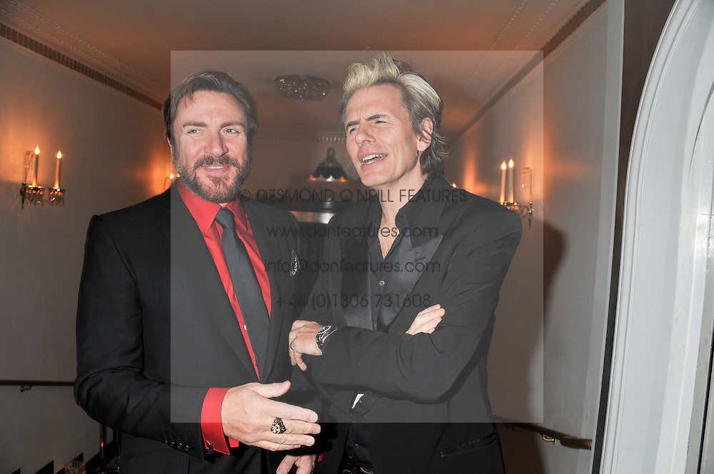 Left to right, SIMON LE BON and JOHN TAYLOR at the Harper's Bazaar Women of the Year Awards 2011 held at Claridge's, Brook Street, London on 7th November 2011.