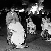 Residents are evacuated from their nursing home as a fire rages out of control in Kansas City, Missouri. 1979