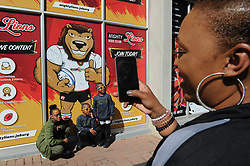 28-07-18 Emirates Airline Park, Johannesburg. Super Rugby semi-final Emirates Lions vs NSW Waratahs. Lions fans, Jade takes a photo of family Leandre Walters(10), twins Shayden and Seth Goldsmith(7).<br /> Picture: Karen Sandison/African News Agency (ANA)