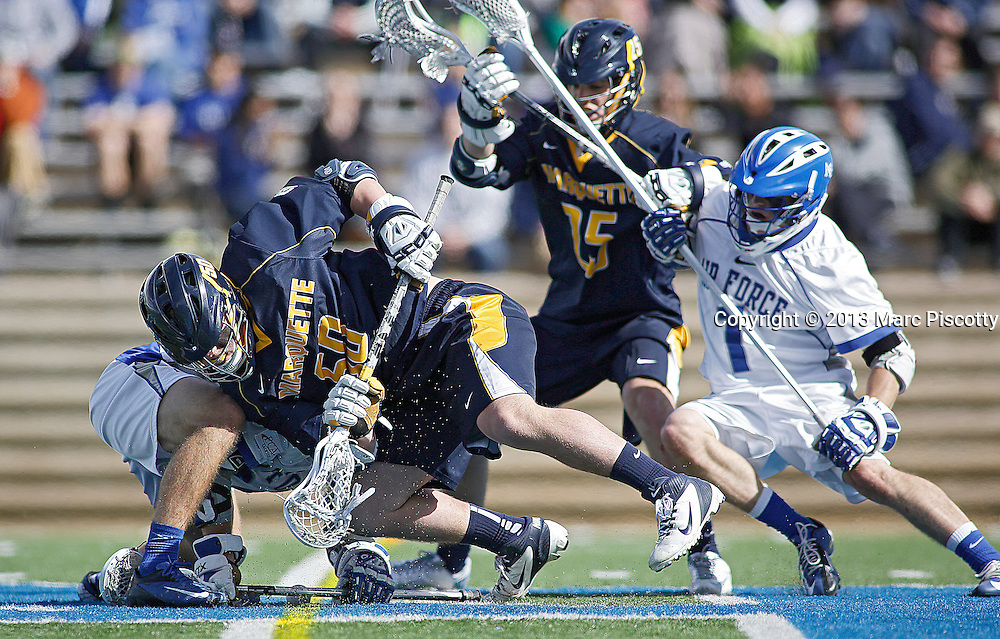 SHOT 3/2/13 1:22:40 PM - Marquette's Paul Riportella #50 battles for a face-off during their college lacrosse game against Air Force at Falcon Stadium in Colorado Springs, Co. Marquette won the game 8-6 marking their first ever win as a new program. (Photo by Marc Piscotty / © 2013)