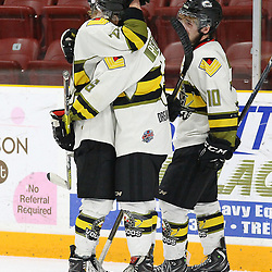 TRENTON, ON  - MAY 5,  2017: Canadian Junior Hockey League, Central Canadian Jr. &quot;A&quot; Championship. The Dudley Hewitt Cup Game 7 between Georgetown Raiders and the Powassan Voodoos.    Dayton Murray #20 and  Bo Peltier #6 of the Powassan Voodoos hug post game.<br /> (Photo by Alex D'Addese / OJHL Images)