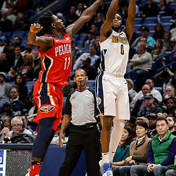 Dec 6, 2017; New Orleans, LA, USA; Denver Nuggets guard Emmanuel Mudiay (0) shoots over New Orleans Pelicans guard Jrue Holiday (11) during the second quarter at the Smoothie King Center. Mandatory Credit: Derick E. Hingle-USA TODAY Sports
