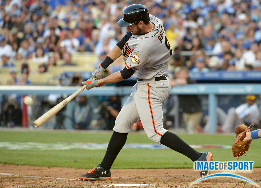 Apr 6, 2014; Los Angeles, CA, USA; San Francisco Giants first baseman Brandon Belt (9) follows through on a solo home run in the sixth inning against the Los Angeles Dodgers at Dodger Stadium. The Dodgers defeated the Giants 6-2.