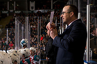 KELOWNA, CANADA - DECEMBER 29: Kelowna Rockets' assistant coach speaks to the press box from the bench against the Kamloops Blazers on December 29, 2018 at Prospera Place in Kelowna, British Columbia, Canada.  (Photo by Marissa Baecker/Shoot the Breeze)