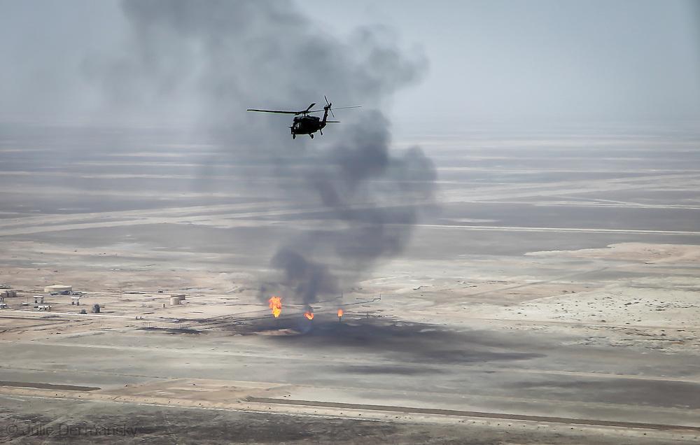 April, 9, 2009, A blackhawk flies over and Iraqi oil field in An Nasiriyah Province in Iraq.