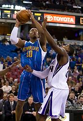 November 29, 2009; Sacramento, CA, USA;  New Orleans Hornets forward David West (30) shoots over Sacramento Kings forward Jason Thompson (34) during the first quarter at the ARCO Arena. Sacramento defeated New Orleans 112-96.