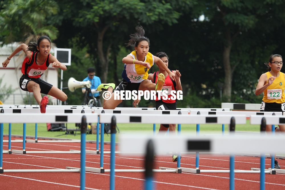 Choa Chu Kang Stadium, Thursday, April 11, 2013 &mdash; Tia Louise Rozario of Singapore Sports School won her first gold in the 80m hurdles event at the 54th National Schools Track and Field Championships, stopping the clock at 12.83 seconds to earn herself a new personal best.<br /> <br /> Story: http://www.redsports.sg/2013/04/15/c-div-girls-80m-hurdles-tia-louise-rozario-sports-school/