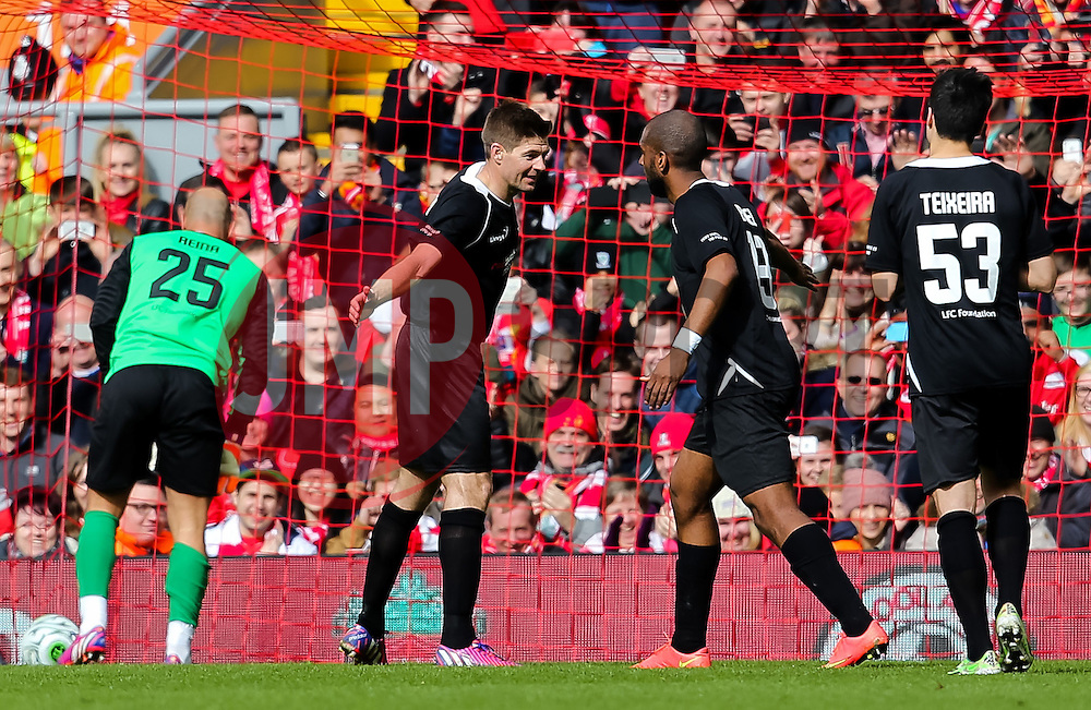 Steven Gerrard celebrates after scoring his first half penalty against Pepe Reina - Photo mandatory by-line: Dougie Allward/JMP - Mobile: 07966 386802 - 29/03/2015 - SPORT - Football - Liverpool - Anfield Stadium - Gerrard's Squad v Carragher's Squad - Liverpool FC All stars Game
