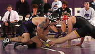 Cornell's Carmen Sacco (left) pulls Simpson's Ryan Napoli back into the circle in the 184 lb weight class match between Simpson College and Cornell College at the Small Multi-Sport Center in Mount Vernon on Wednesday November 19, 2008. Sacco defeated Napoli 5-1 and Cornell won the meet 35-10.