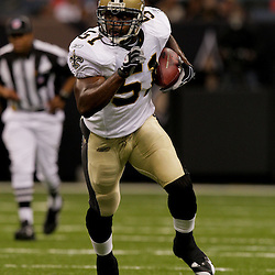2009 August 14: New Orleans Saints linebacker Jonathan Vilma (51) runs back a fumble during the first quarter of the preseason opener between the Cincinnati Bengals and the New Orleans Saints at the Louisiana Superdome in New Orleans, Louisiana.