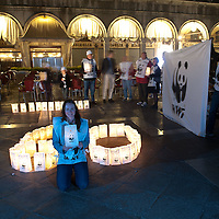 VENICE, ITALY - MARCH 31: A young member  of WWF hold a lantern in St Mark's Square while lights are switched off for Earth Hour 2012 on March 31, 2012 in Venice, Italy. According to organizers, Earth Hour 2012 has participants including individuals, companies and landmarks in 147 countries and territories and over 5,000 cities agreeing to switch off their lights for one hour. The Brandenburg Gate, the Eiffel Tower in Paris, Big Ben Clock Tower in London, the Christ the Redeemer statue in Rio de Janeiro and the Empire State Building in New York are among the monuments whose operators have agreed to participate in the demonstration.  (Photo by Marco Secchi/Getty Images)
