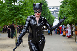 © Licensed to London News Pictures. 28/05/2017. London, UK.  A woman dressed as Catwoman at MCM Comic Con taking place at Excel in East London.  The three day event celebrates popular comic books, anime, games, television and movies.  Many attendees take the opportunity to dress as their favourite characters.    Photo credit : Stephen Chung/LNP