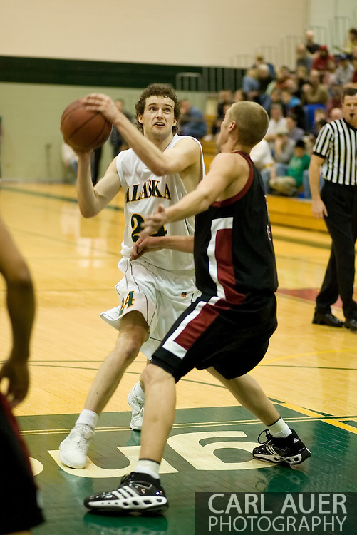 1/6/2006: Sophomore forward Ivan Platenik (24) of the UAA Seawolves looks for a open shot as Anchorage goes on to beat the visiting Central Washington Wildcats, 80-60 at the Wells Fargo Sports Complex on the campus of UAA.<br />