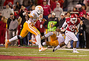 Nov 12, 2011; Fayetteville, AR, USA;  Tennessee Volunteers linebacker Curt Maggitt (56) brings down Arkansas Razorbacks running back De'Anthony Curtis (23) causing a fumble during a game at Donald W. Reynolds Razorback Stadium. Arkansas defeated Tennessee 49-7. Mandatory Credit: Beth Hall-US PRESSWIRE