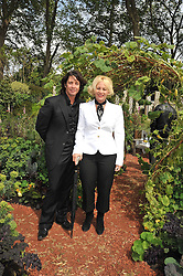 LAURENCE LLEWELLYN-BOWEN and his wife JACKIE at the RHS Chelsea Flower Show 2009 held inthe gardens of the Royal Hospital Chelsea on 18th May 2009.
