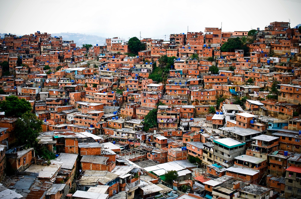 Hundreds of thousands of Venezuelans live in cinder block houses in the slums that blanket the hills in and around Caracas. Recent flooding has triggered landslides that have killed 25 people and displaced more than 30,000 Venezuelans from their homes. Hugo Chávez recently signaled plans to expropriate the Caracas Country Club, in order to use the property to build thousands of low cost apartments to alleviate the city's housing shortage.