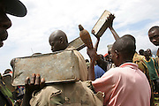 Photos of in Mbanda near Macamba, south of Burundi. CNDD-FDD man surrendering his weapons to the UN registration desk. Seen here giving it up to Colonel Tahir..Thursday 03 February 2005, Martine Perret. ONUB/Burundi