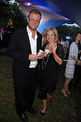MARIELLA FROSTRUP and her husband JASON McCUE at the annual Serpentine Gallery Summer Party in association with Swarovski held at the gallery, Kensington Gardens, London on 11th July 2007.<br />