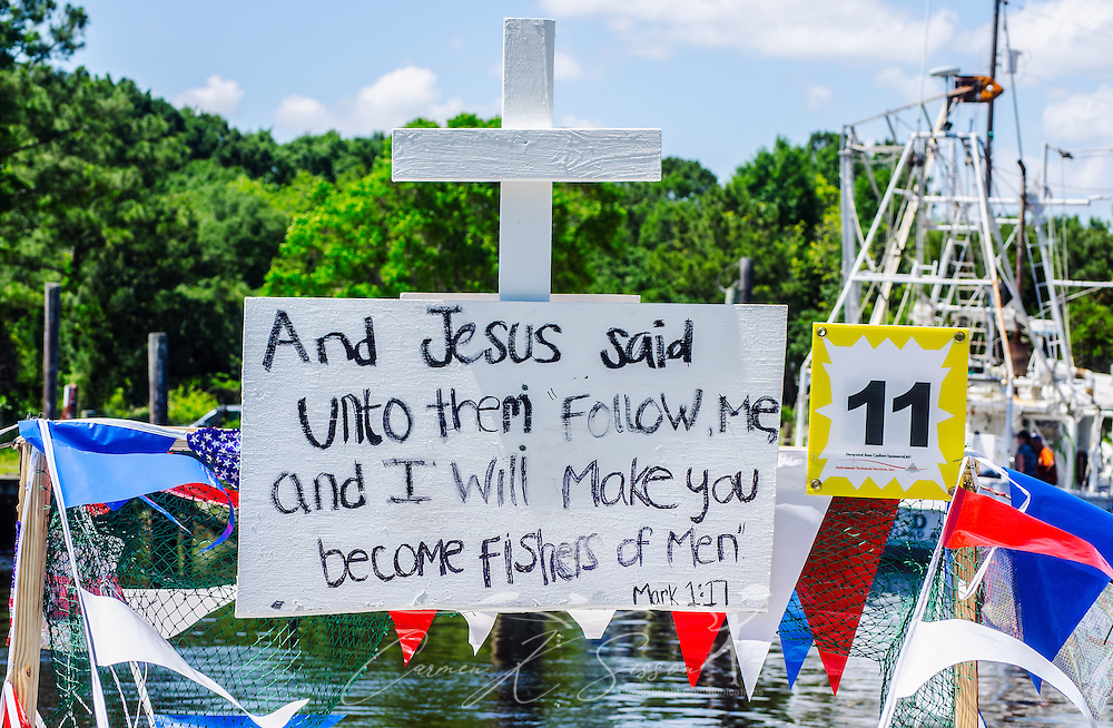 A decorated boat participates in the 66th annual Blessing of the Fleet in Bayou La Batre, Alabama, May 3, 2015. The first fleet blessing was held by St. Margaret's Catholic Church in 1949, carrying on a long European tradition of asking God's favor for a bountiful seafood harvest and protection from the perils of the sea. The highlight of the event is a blessing of the boats by the local Catholic archbishop and the tossing of a ceremonial wreath in memory of those who have lost their lives at sea. The event also includes a land parade and a parade of decorated boats that slowly cruise through the bayou. (Photo by Carmen K. Sisson/Cloudybright)