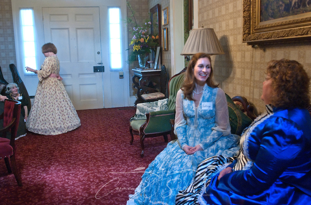 Kathryn Gittone (left) and Rachel George take a break from giving tours at Twelve Gables in Columbus, Miss. April 16, 2010. The 1838 home  was among nearly two dozen on tour during Columbus' annual Spring Pilgrimage. (Photo by Carmen K. Sisson/Cloudybright)