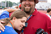 Coach and athlete enjoy victory at award ceremony. Special Olympics U of M Bierman Athletic Complex. Minneapolis Minnesota USA