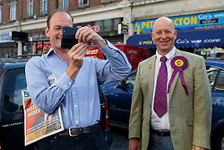 © Licensed to London News Pictures. 10/10/2014. Clacton, UK. Douglas Carswell, newly elected and first ever MP of UKIP for Clacton-on-Sea takes a picture of the press pack following him as he visits at Clacton town centre on Friday, 10 October, 2014 after his victory in the by-election of Clacton-on-Sea. Photo credit : Tolga Akmen/LNP