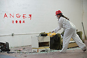 Diane Casanova smashes things during her session at the Anger Room in Dallas, Texas on November 18, 2016. (Cooper Neill for The New York Times)