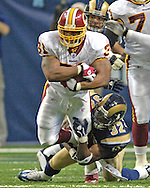 Washington's Rock Cartwright (31) is tackled from behind by St. Louis Rams defensive back ron Bartell (32) in the fourth quarter, at the Edward Jones Dome in St. Louis, Missouri, December 4, 2005.  The Redskins beat the Rams 24-9.
