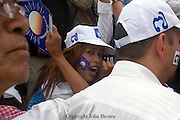 A young Cambodian woman is attending an election campaign rally for opposing CNRP led by Sam Rainsy in Kampong Cham, Cambodia.