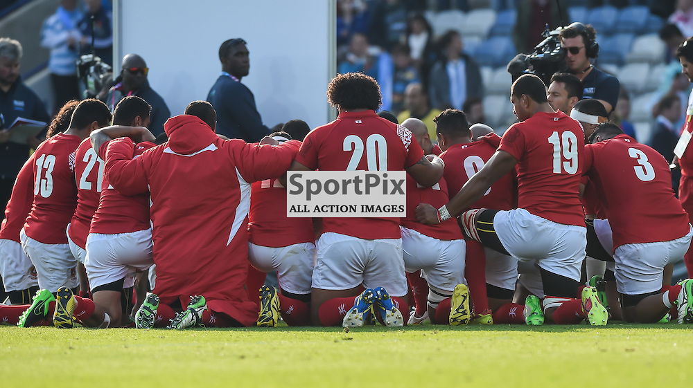 Tongan players go in to a huddle after the full time whistle (c) Simon Kimber | SportPix.org.uk