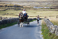 A weekend of glorious weather welcomed approximately 150 people from all over the country and abroad to Inis Mor , Arann Islands to participate in the annual Aer Arann half marathon.  Over the past ten years people have walked and ran the roads of Inis Mor to raise in excess of 1.2 million to purchase vital life saving equipment for sick children in both Crumlin and Temple Street hospitals.  Lisa Cusack from Lucan in Dublin being over taken by a pony and trap . Photo:Andrew Downes.