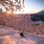 Jake Cohn drops into a sunset line on Shiribetsu-Dake, Rusutsu, Japan