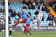 Scunthorpe United player Rory McArdle (23) and Colchester United player Luke Norris(9) during the EFL Sky Bet League 2 match between Scunthorpe United and Colchester United at Glanford Park, Scunthorpe, England on 14 December 2019.