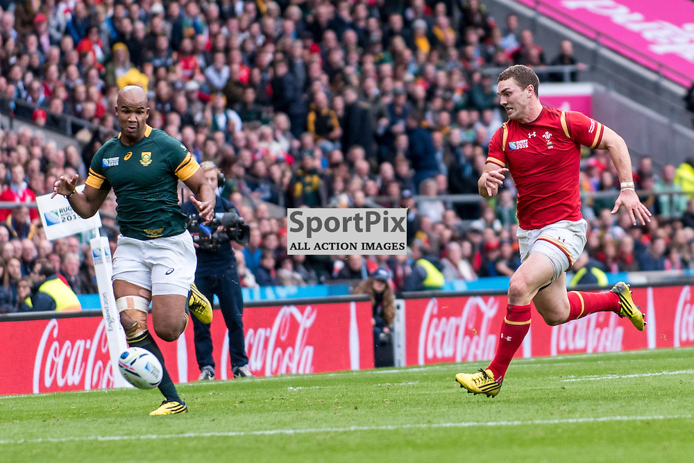 South Africa's JP Pietersen (a World Cup winner in 2007) and George North of Wales race for the ball. Action from the South Africa v Wales quarter final game at the 2015 Rugby World Cup at Twickenham in London, 17 October 2015. (c) Paul J Roberts / Sportpix.org.uk