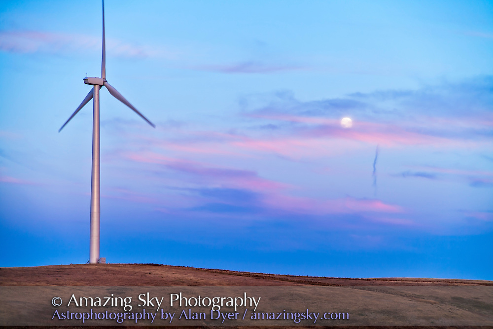 The September 28, 2012 Harvest Moon, with a wind turbine from the Wintering Hills Wind Farm near Drumheller, Alberta. Taken as part of a time lapse movie sequence. Canon 5D MkII and 28-105mm lens, automatic exposure. The dark blue above the horizon is the shadow of the Earth.