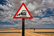 Namibia is filled with interesting and quirky triangular road signs.  This one depicts oncoming train and train tracks.